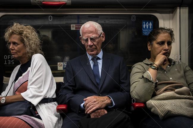 London, England - 12 June 2018: People traveling in London metro