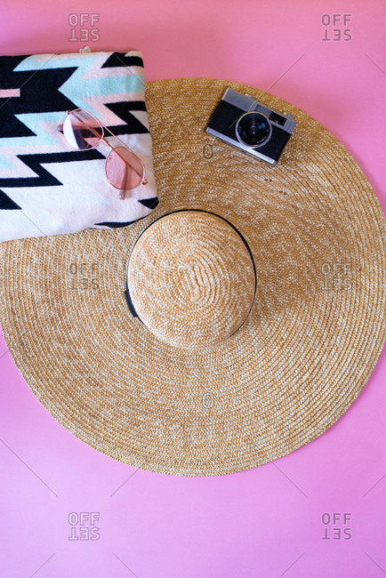 Summer trendy sunglasses, towel, hat and camera beach accessories