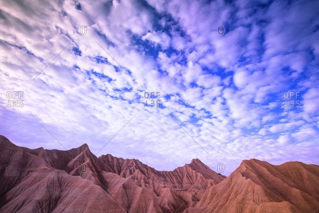 Peak of stone mountain and amazing azure heaven with clouds in Bardenas Reales, Navarra, Spain