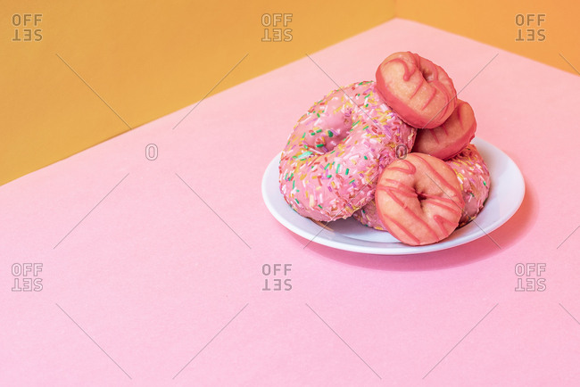 Pink doughnuts in a colorful background