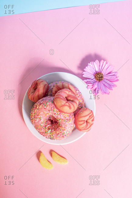 Pink doughnuts with banana shape candies and flower