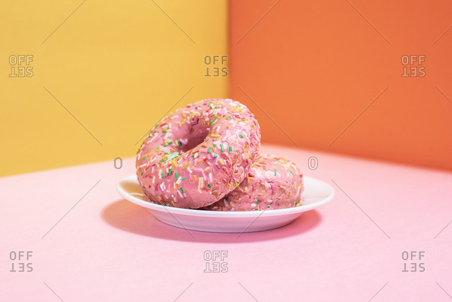 Pink doughnuts in a multicolor background