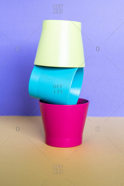 Multicolor vases in a colorful background