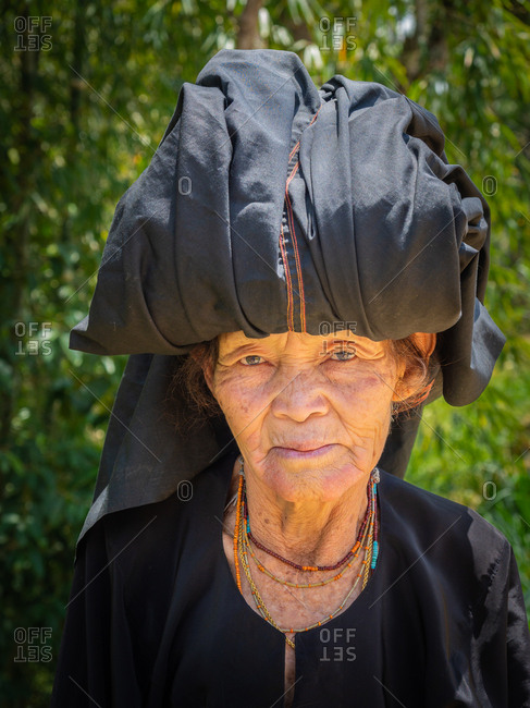 Sulawesi Island, Indonesia - August, 15 2015: Elderly woman in shed in village