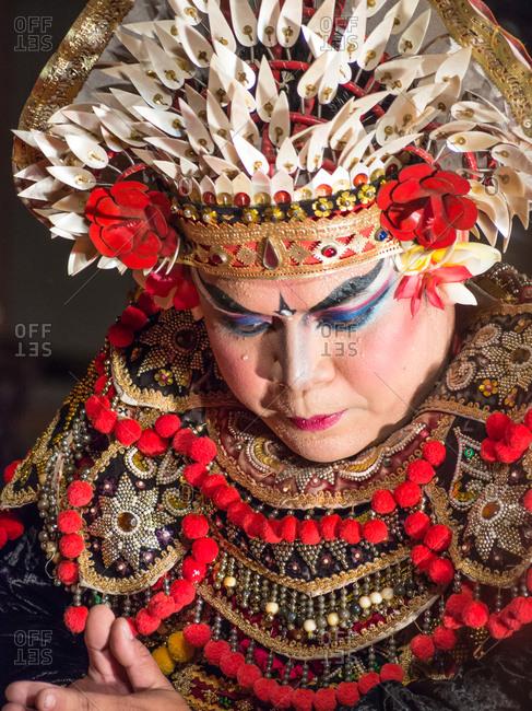 Bali, Indonesia - August, 15 2015: Ethnic woman dancing traditional dance