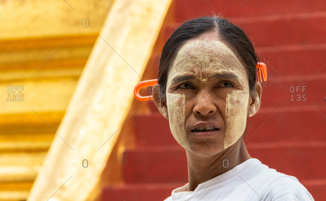 Bagan, Myanmar - June, 25 2012: Ethnic woman with painted face
