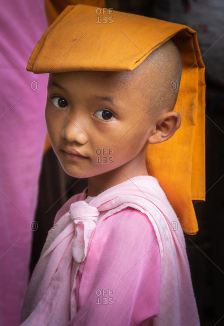 Mandalay, Myanmar - June, 25 2012: Monk boys in monastery yard
