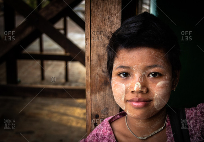 Bagan, Myanmar - June, 25 2012: Little ethnic girl with painted face
