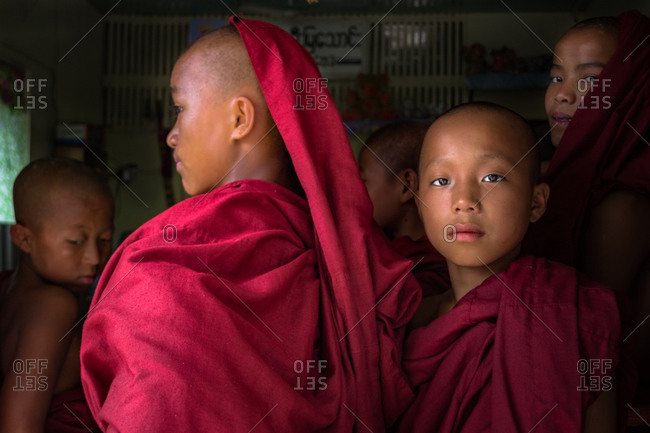 Mandalay, Myanmar - June, 25 2012: Monk boys standing in queue for food