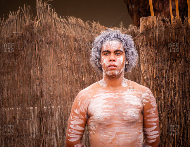 Uluru Outback, Australia - March, 09 2015: Australian aborigines dancing together