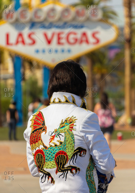 Las Vegas, USA - September, 13 2011: Back view of Elvis Presley impersonator in white jacket with bright ornament standing on blurred background of city street