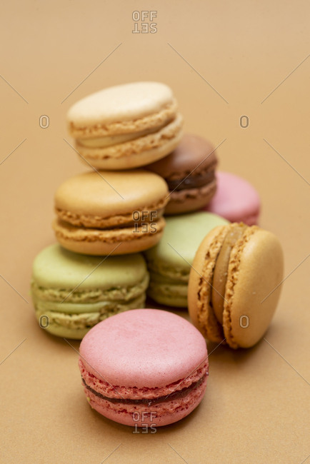 Arrangement of pastel-colored macaroons on brown paper