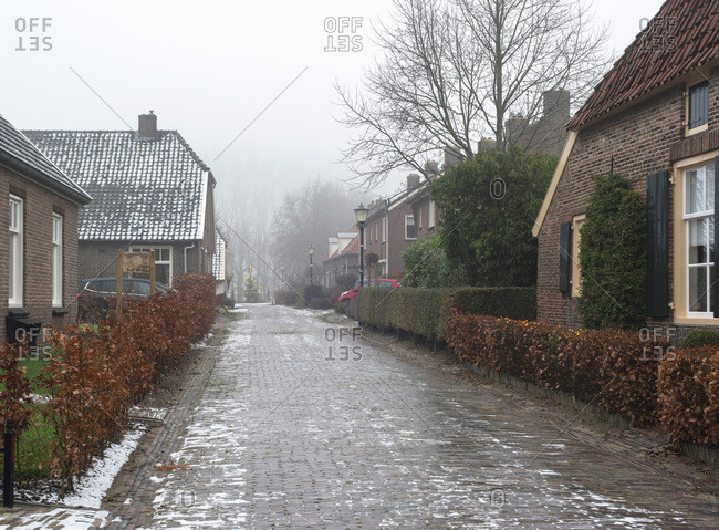 Cobblestone residential street in winter