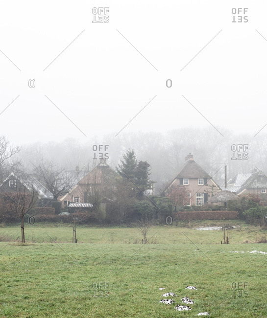 View of quaint village on a foggy day