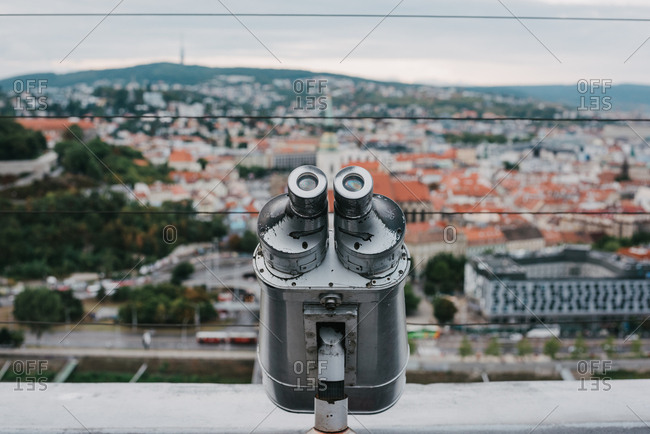 Old tower viewer binoculars and the city of Bratislava in the background