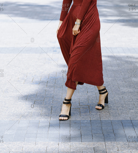 Woman in modern dress dancing on the street