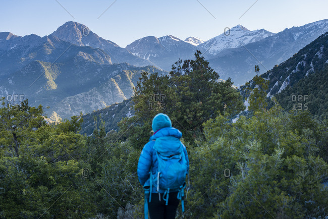 b388604e2e21a8 ... A woman trekking in Greece looks out at Mount Taygetus the highest peak on  the Peloponnese