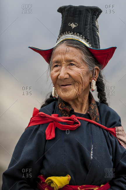 A Nubra woman wears traditional dress to attend a gathering at a local monastery in the Nubra valley