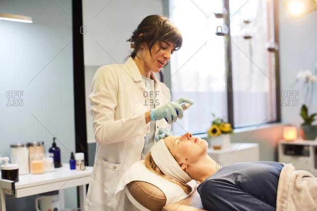 Dermatologist preparing client for a cosmetic procedure