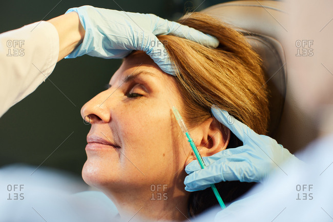 Woman getting facial injections