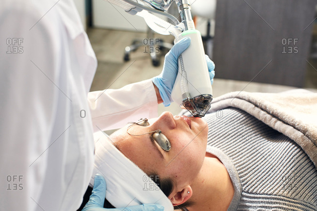Woman having a laser cosmetic procedure