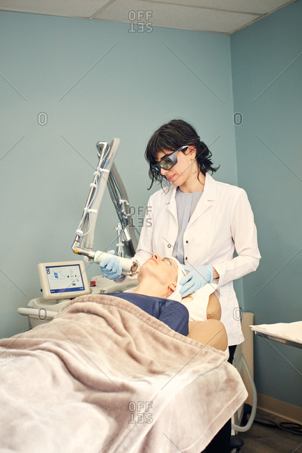 Dermatologist performing a laser procedure