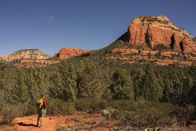 Backpacker admiring sandstone formations in Arizona