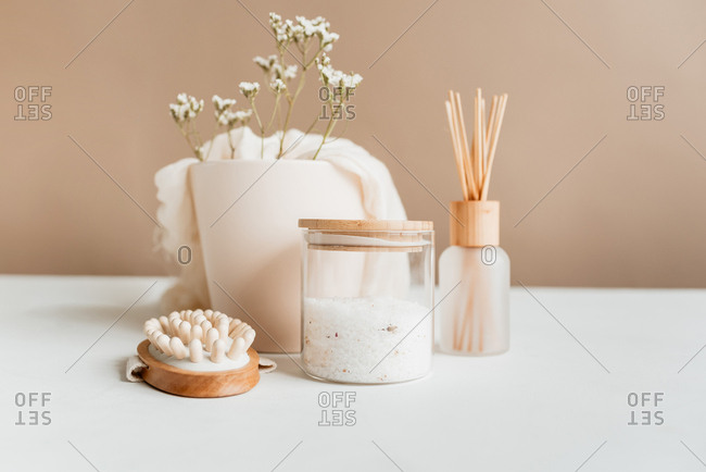 spa items on white table with pecan wall