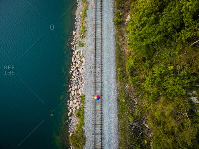 Concept aerial view man escalating rail tracks, Wisconsin, USA.
