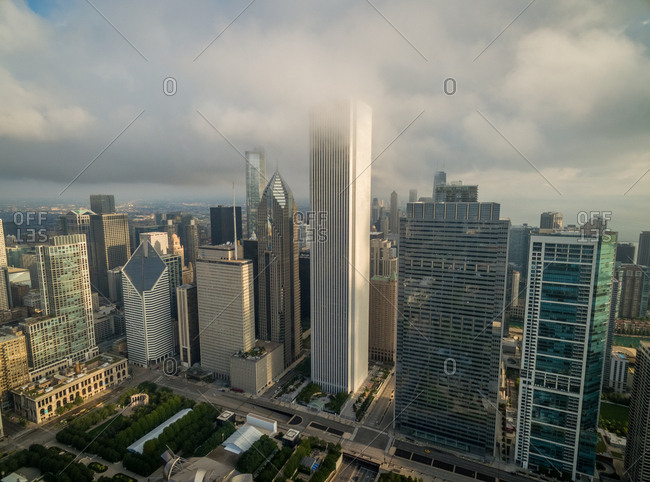 Aerial view of mist covering tall building downtown Chicago, USA.