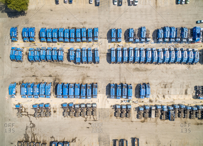 Aerial view of blue garbage trucks parking together, Chicago, USA.