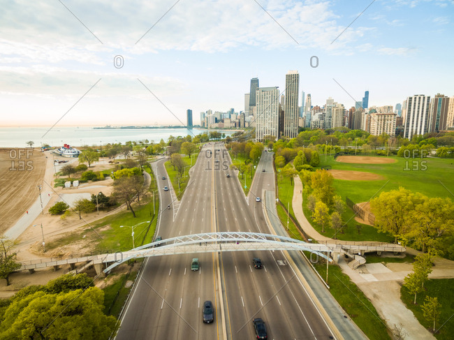 Aerial view of multi-lane road leading towards Chicago downtown, USA.