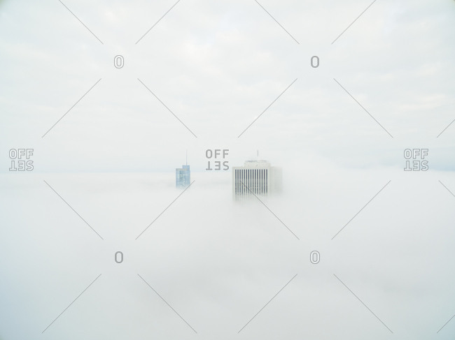 Aerial view of single tall skyscraper over the clouds, Chicago, USA.
