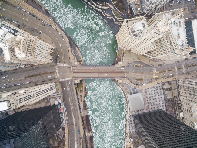 Aerial view of frozen Chicago River crossing business center, USA.