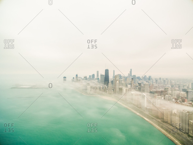 Aerial view of mist covering Chicago coastal line, USA.