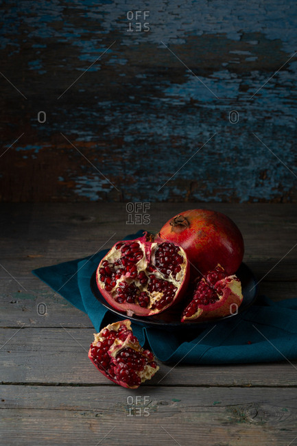 Whole and a half of pomegranates