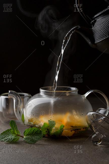 Pouring hot tea