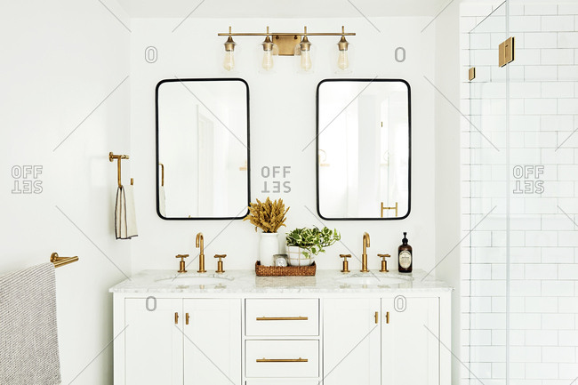 Los Angeles, California - November 21, 2018: Modern bathroom vanity with bronze fixtures
