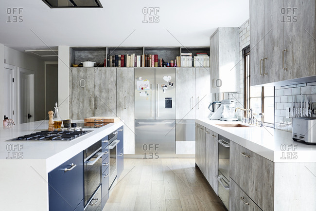 Los Angeles, California - November 30, 2018: Modern kitchen with large island and blue cabinets