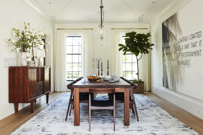 Los Angeles, California - February 14, 2015: Dining room with large wooden table and credenza