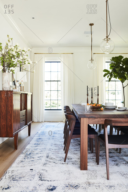 Los Angeles, California - February 14, 2015: Dining room with large wooden credenza and table