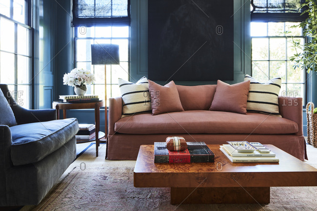 Los Angeles, California - February 14, 2015: Pink sofa in a sitting room with dark blue walls