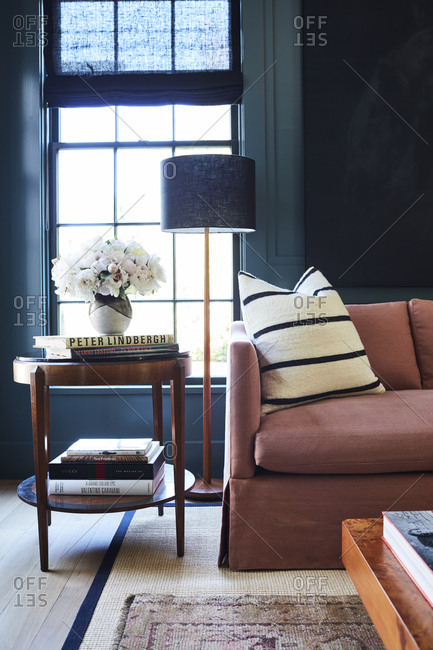 Los Angeles, California - February 14, 2015: Sofa and side table in a room with dark blue walls