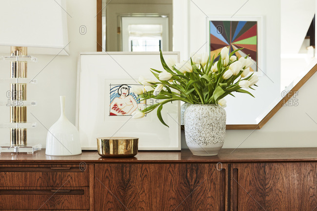Los Angeles, California - February 14, 2015: Close up of a credenza with tulips and artwork