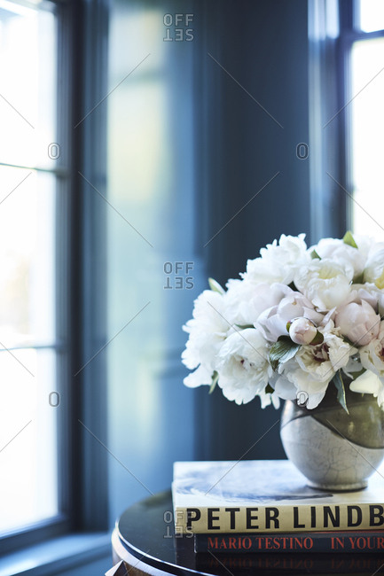 Los Angeles, California - February 14, 2015: Floral arrangement on top of books on a side table