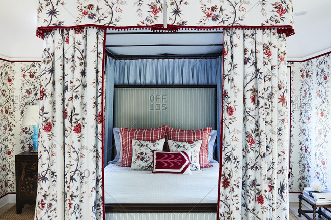 Los Angeles, California - October 4, 2016: Bedroom with floral wallpaper and canopy around bed