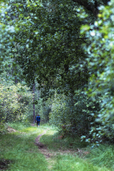 Woman walking on nature path