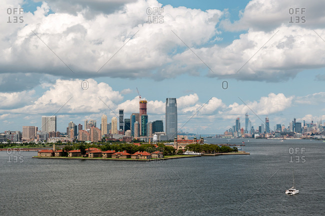 New York City, USA - August 22, 2018: Ellis Island and midtown Manhattan skyscrapers view from the Statue of Liberty