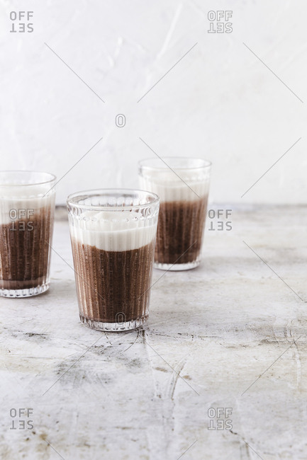 Three caffe mochas on concrete background