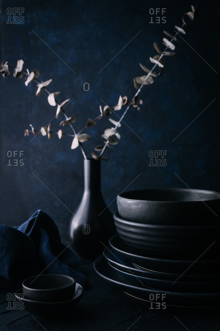 Still life of dark ceramic kitchenware